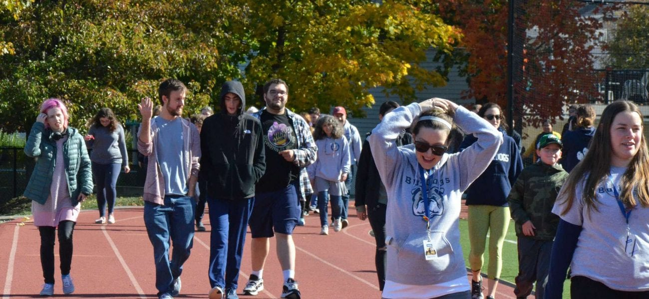 students walking in the 5th Annual March a Mile for Milestones Charity Walk