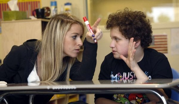 a teacher helping a student in the classroom