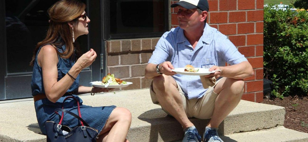 Two faculty members conversing